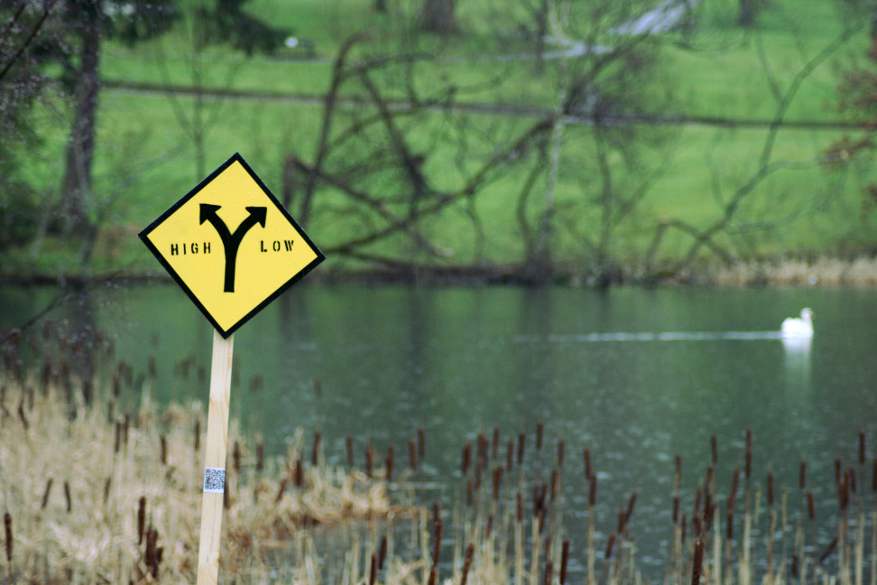 sign against a water back drop